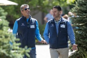 Casey Wasserman, founder and chief executive officer of Wasserman Media Group LLC, left, and Jeff Wilpon, senior executive vice president and chief operating officer of the New York Mets, wore customized vests. PHOTO: DAVID PAUL MORRIS/BLOOMBERG NEWS